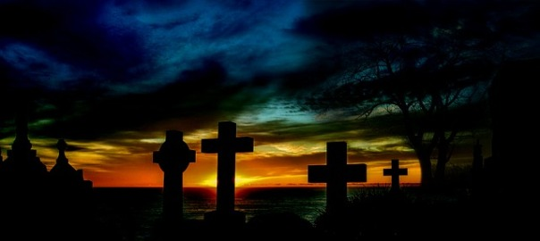 visit a cemetery, cemetery with surise colors and clouds